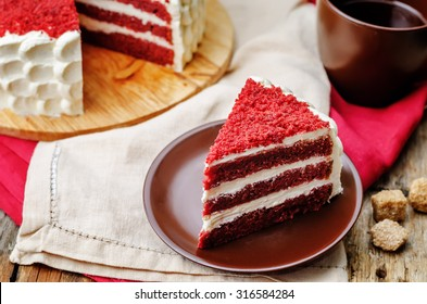 Red velvet cake on a dark wood background. the toning. selective focus
