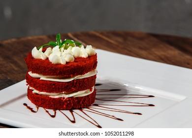 Red Velvet Cake On White Square Plate Rustic Wooden Table
