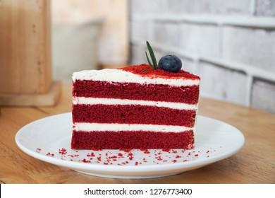 Red velvet cake on wood background.