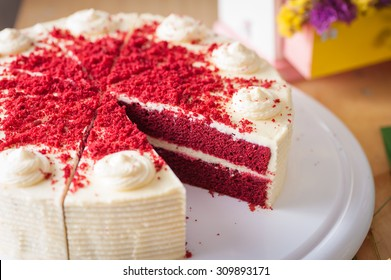 Red velvet cake on wood table with morning scene