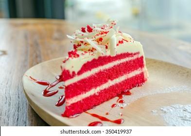 Red velvet cake on wood plate