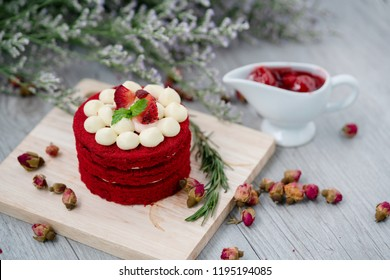 The Red Velvet Cake is placed on a wooden floor. It is suitable for parties in festivals of happiness such as Valentine's Day, Christmas, Happy New Year and a menu that must be in the coffee shop.