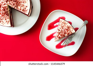 Red Velvet cake slice on red background. Top view