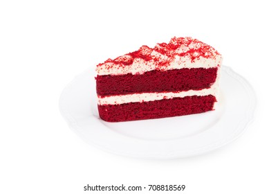 Red Velvet Cake sliced in piece on white plate over red place mat isolated on white background (Clipping path included) for celebrate X'mas season or Valentines day with copy space for text insertion