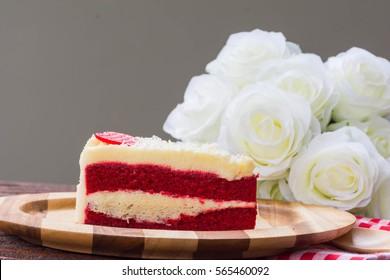 red velvet cake and white roses decoration on the table for valentine's day