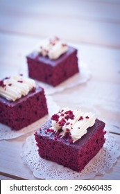 Red velvet cakes on wooden board
