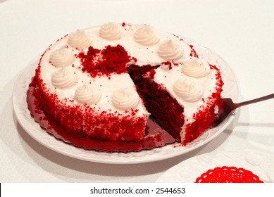 Red Velvet Chocolate Cake - Close up of a Red Velvet Chocolate Cake birthday cake and a slice being served.