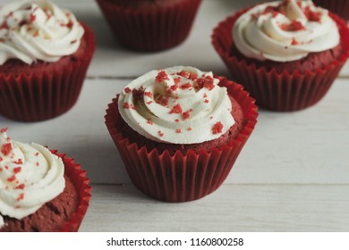 Red Velvet Cup Cake on wood background.