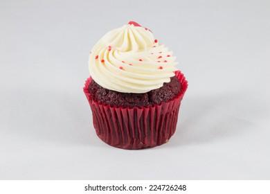Red velvet cup cake on white background.