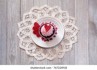 Red velvet cupcake decorated for with red hearts for Valentine's day