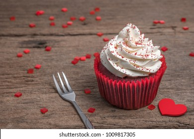 red velvet cupcake on wooden table for love and valentine's day.