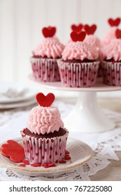 Red velvet cupcakes decorated for with red hearts for Valentine's day