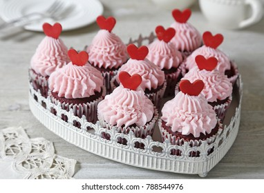Red velvet cupcakes decorated with red hearts