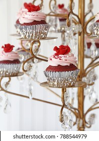 Red Velvet cupcakes displayed on a chandelier