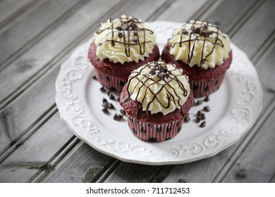 Red velvet cupcakes on gray weathered wood