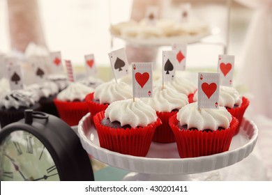 Red velvet cupcakes with playing cards toppers, Alice in wonderland mad hatters tea party
