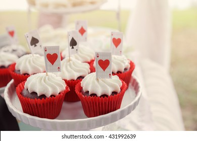 Red velvet cupcakes with playing cards toppers, Alice in wonderland tea party theme,toning