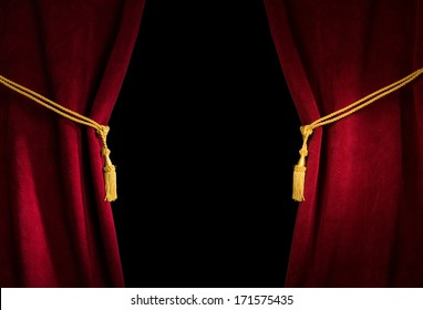 Red velvet curtain with tassel. Close up black isolated curtain