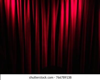 Red velvet drapes.