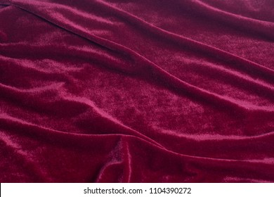 Red velvet fabric background texture.