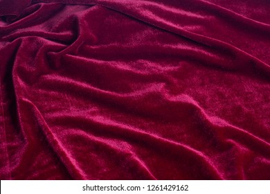 Red velvet fabric background texture.