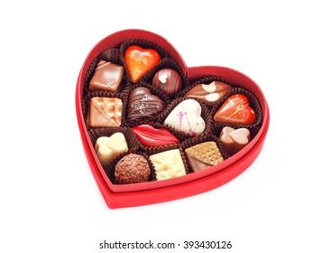 Red velvet, heart shaped box of chocolates. Shot on white background.