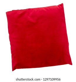 Red velvet luxury cushion isolated on white background, top view.