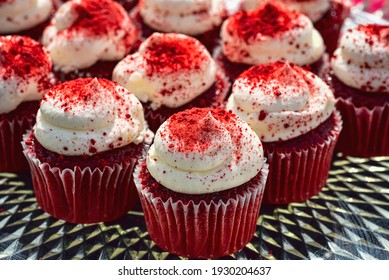 red velvet mini cupcakes with white frosting dusted with red sugar