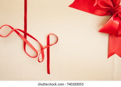 Red Velvet Ribbon, Silk bow, Satin Background for Christmas Holiday or Valentines Day themes.