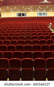 red velvet seats for spectators in the theater or cinema
