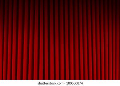Red Velvet Stage Curtains Dim Lit Background.