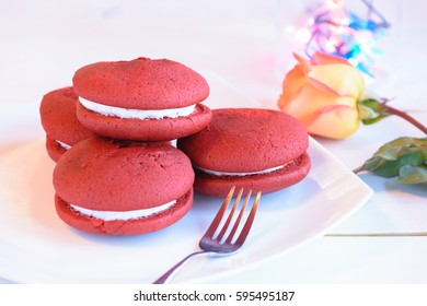 Red Velvet Whoopie Pie Vanilla Iced On a White Table Background / Selective focus