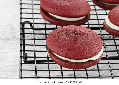 Red velvet whoopie pies or moon pies. Shallow depth of field.
