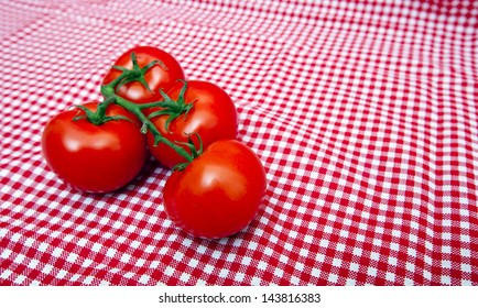 Red Vine tomatoes against red and white gingham cloth