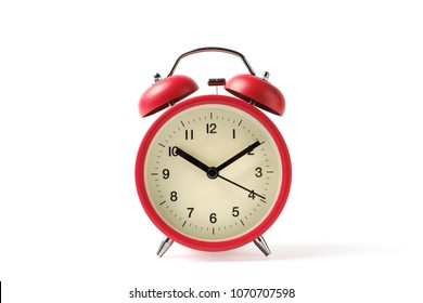 Red vintage alarm clock on white background with clipping path