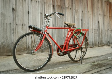 Red vintage  bikes and background wooden doors