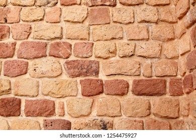 Red vintage brick wall background. Uneven vintage bricks. Colonial bricks