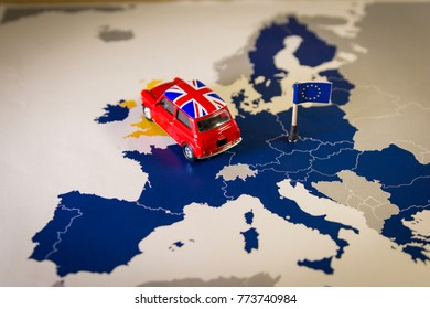 Red vintage car with Union Jack flag over an UE map and flag. Symbolizing the Brexit concept.The UK is thus on course to leave the EU on 29 March 2019