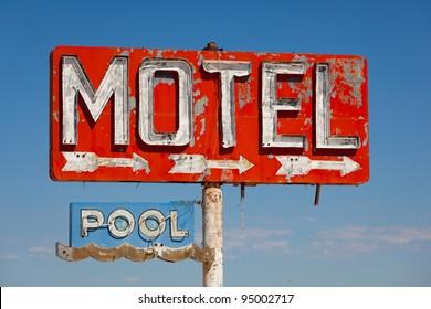 Red, vintage, neon motel sign on blue sky