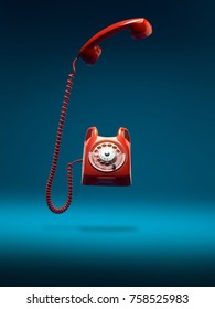 red vintage phone ringing with handset off the hook, on blue background