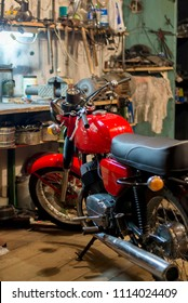Red vintage retro motorcycle parked in the garage