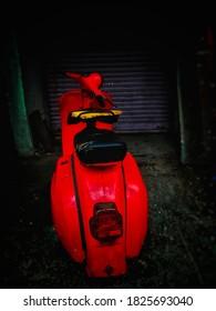 red vintage scooter background for social media