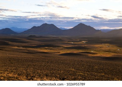 Red volcanic landscape scenery with inland view of Iceland on the warm sunset light