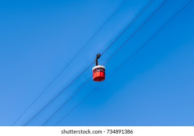 Red wagon of Port Vell Aerial Tramway operating in Barcelona, Catalonia, Spain