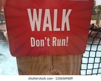red walk don't run sign near water