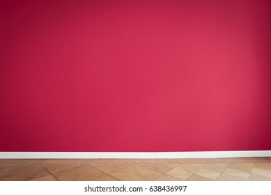 red wall background, empty apartment room