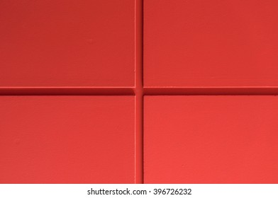 Red wall background with groove line.