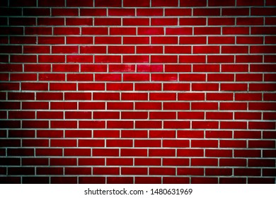 Red wall brick background color ,vignetted