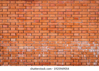 Red wall brick background texture or pattern. selective focus