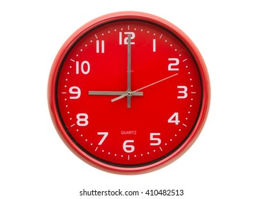 Red wall clock isolated on white background.
